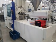 Injection Battenfeld HM 130/750 with a robot