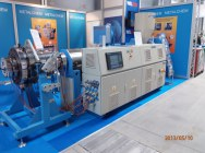 W90-30d extruder with a 90R250S pipe head, unused, presented at the fair