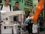 Robot przemysłowegy KUKA współpracujący z drukarką tamponową Tampotechniki