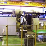 Robotized cells for manufacturing automotive parts