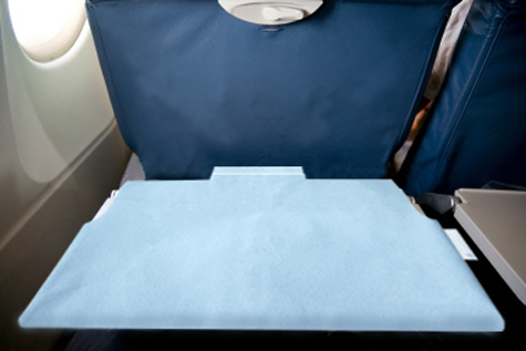 trayGUARD+ environmentally friendly antimicrobial tray table cover for personal use on airplanes, trains and buses